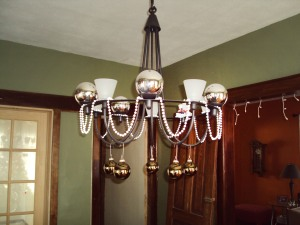 Decorated dining room chandelier.