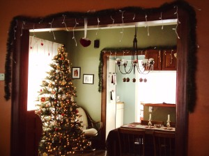 Looking into the dining room. Garlands and icicle lights baby!
